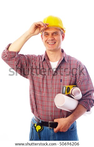 handsome man - builder with drawings smiles and adjusts his helmet hand