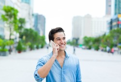 Handsome man cell phone call smile outdoor city street, Young attractive businessman casual blue shirt talking