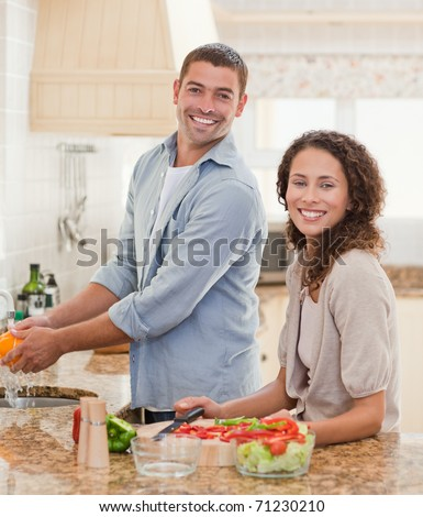Handsome man cooking with his girlfriend at home