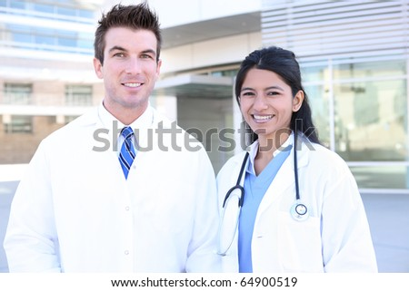 Handsome man doctor and woman nurse outside hospital