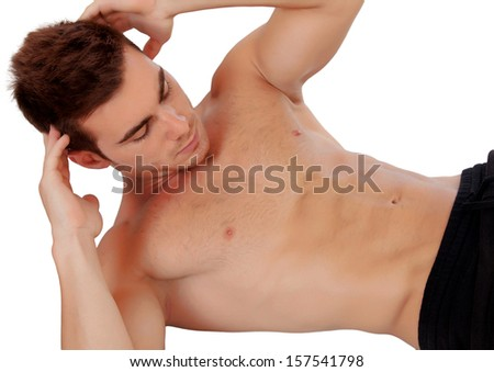Handsome man doing sit-ups isolated on a white background