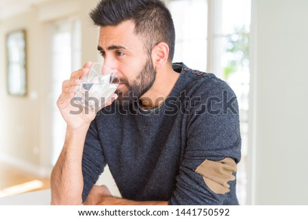 Handsome man drinking a fresh glass of water