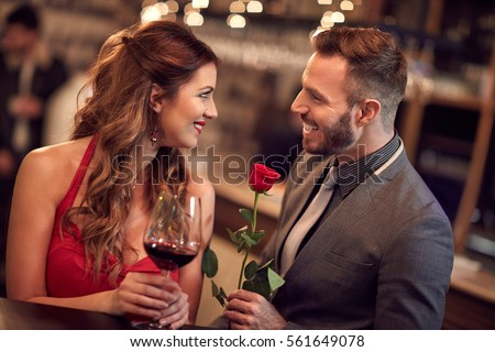 Shutterstock Handsome man giving rose to attractive lady