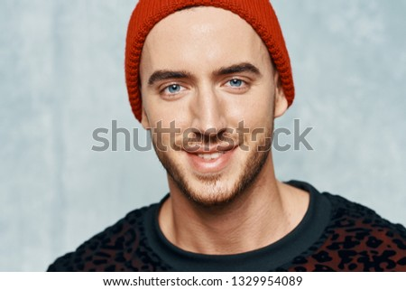 Handsome man handsome face red hat sweater cropped look                             #1329954089