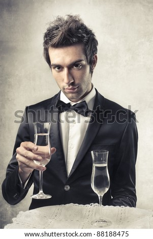 stock-photo-handsome-man-holding-a-glass-of-wine-88188475.jpg
