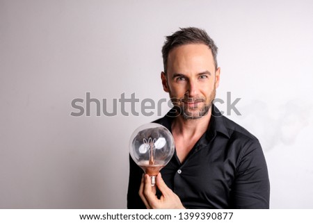 Handsome man holding a snowglobe.