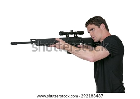 Handsome man holding an automatic assault rifle