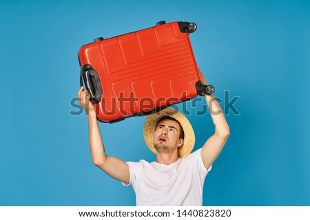 handsome man holds red suitcase passenger travel vacation confidence confidence luggage