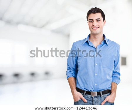 Handsome man in a bright room