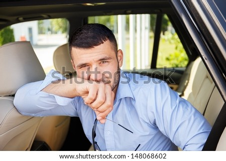 Handsome man in a car interior