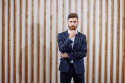 Handsome man in a dark blue stylish suit.