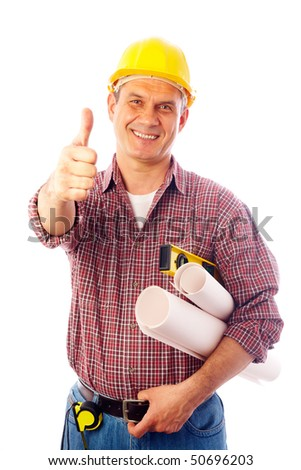 handsome man in a helmet with a builder tool shows a gesture OK