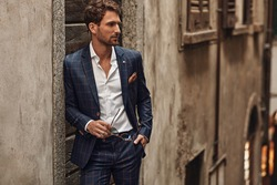 Handsome man in classik checked suit thinking