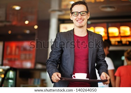 handsome man in fastfood restaurant