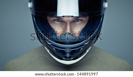 Handsome man in helmet on blue background