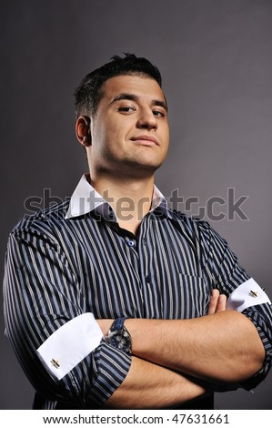 Handsome man isolated on grey background