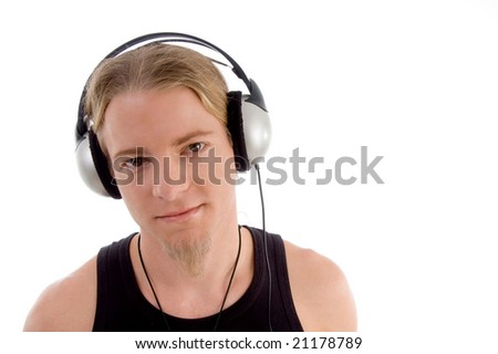 handsome man listening to music with white background