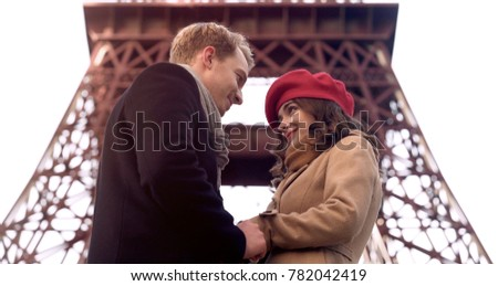 Handsome man looking at beautiful woman with love, first date, romance in Paris #782042419