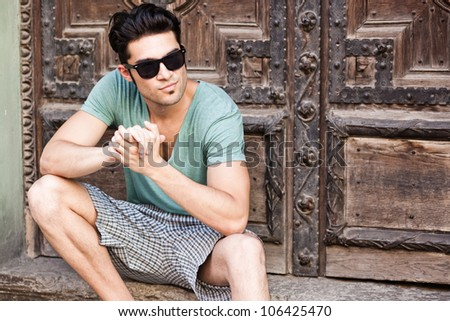 handsome man looking serious wearing sunglasses