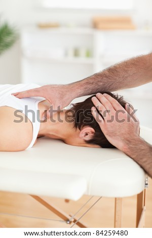 Handsome Man massaging a charming woman's neck in a room - stock photo