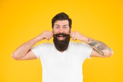Handsome man mustache twirl barbershop services, playful mood concept.