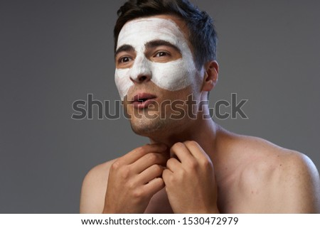 Handsome man naked shoulders face mask spa treatment treatment