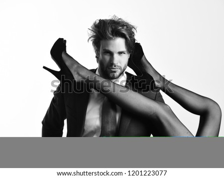 handsome man or businessman in suit and female sexy legs in fashionable shoes and tights isolated on white background, love and relations, power, boss, office romance, sexual services, couple in love #1201223077