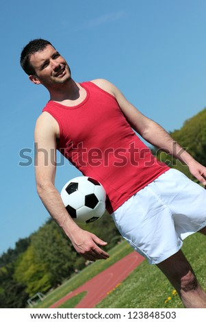 handsome man outdoor with a ball