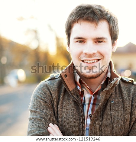 Handsome man outdoors portrait. Autumn colors.