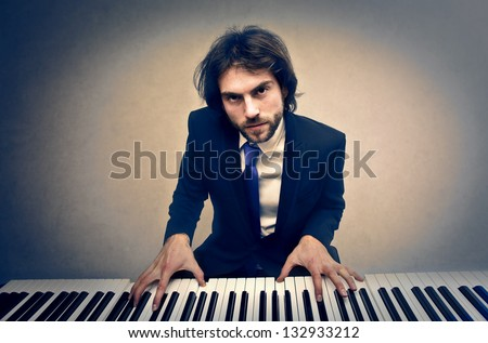 handsome man playing piano