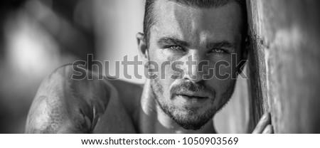 Handsome man portrait in black / white #1050903569
