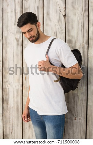 Handsome man posing against wooden background #711500008