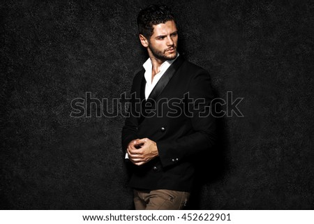 Handsome man posing, night life.