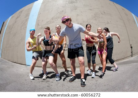 Handsome man posing with several fellow athletes - stock photo