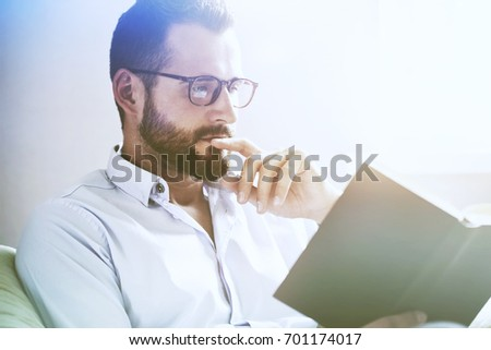 handsome man reading interesting book #701174017