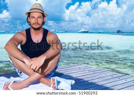 Handsome man resting near water at Maldives #51900292