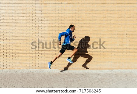 handsome man running in the...