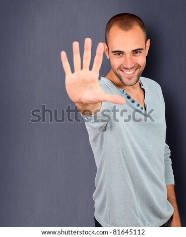 Handsome man showing hand to camera
