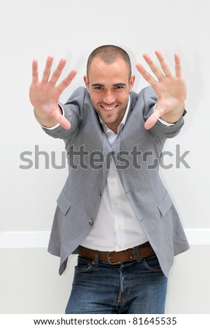 Handsome man showing hands to camera
