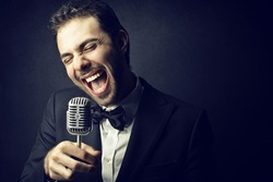 handsome man singing with microphone