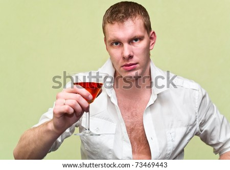 stock photo : Handsome man sitting with glass of alcohol. Caucasian gay