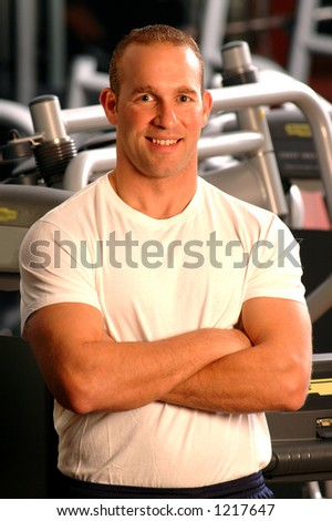 handsome man smiling in fitness center