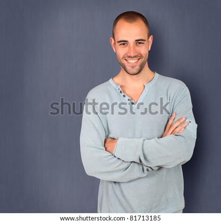 Handsome man standing on blue background