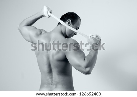 handsome man straining back muscles and arms