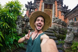 Handsome man taking a selfie on a trip in Asia