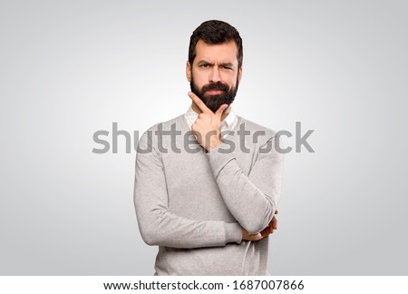 Handsome man thinking over isolated grey background