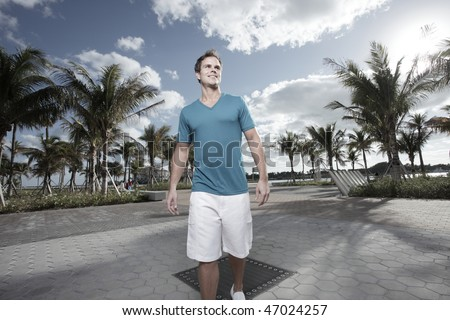 Handsome man walking in the park