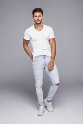 Handsome man wearing jeans and white t-shirt