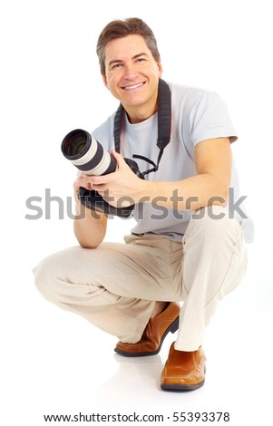 Handsome man with a photo camera. Isolated over white background