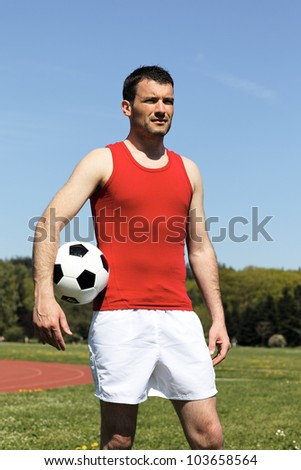 handsome man with ball under the arm